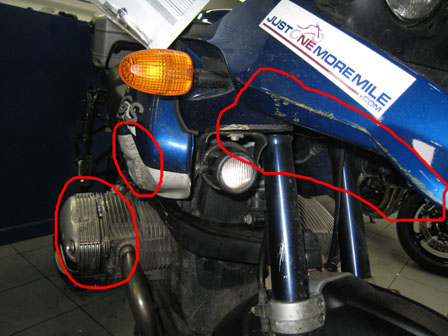 My bike, showing paint transfer on beak, dent in tank and squashed fins on the top of the engine cylinder…