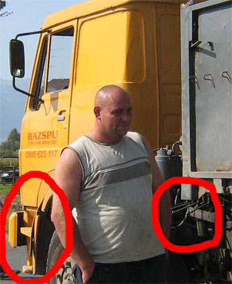 The truck driver surveys the damage – clearly visible are the marks on the front where the bike hit, and the missing control level…