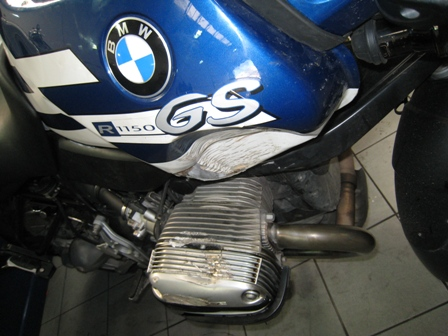 Damage to my bike, with big dent in tank and crushed engine