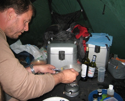 Cooking inside the tent during a storm…