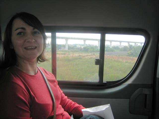 Tracy, sat in the minibus en-route to Bangkok