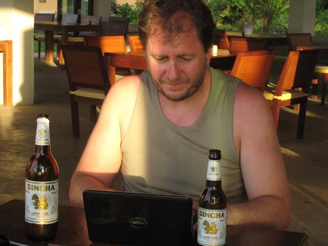 Paul updates the blog, with a beer for each hand...