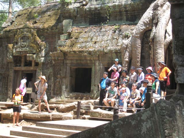 The whooping Koreans get behind the barriers for that all important Ta Prohm photo...