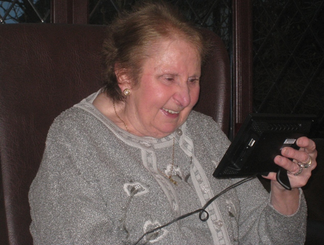 Mum enjoying the photos of us as kids on her new Christmas present
