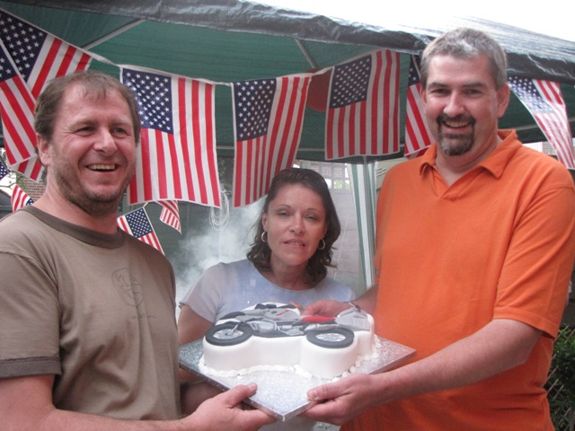 Richard, Karen and Paul pose with the cake...