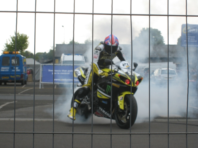 James Toseland destroys his rear tyre for the crowd