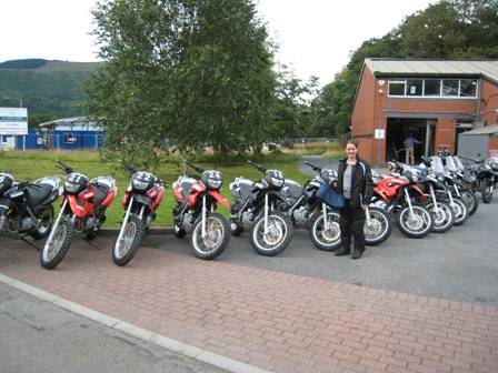 Tracy with the bikes outside the Off Road School